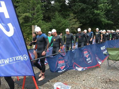 """First group of men entering the """"shoot"""" for the half iron distance swim"""